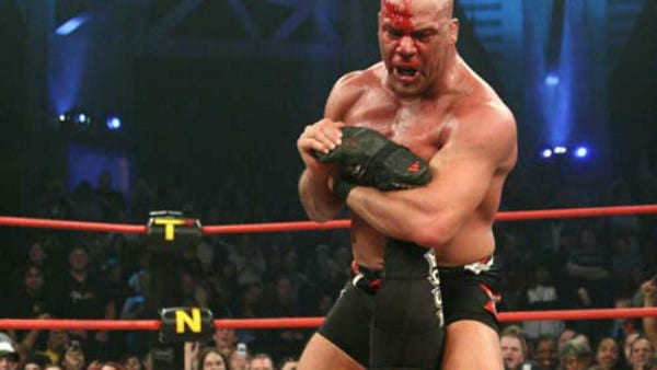 A bloody Kurt Angle holds Samoa Joe in the ankle lock at TNA Genesis 2006