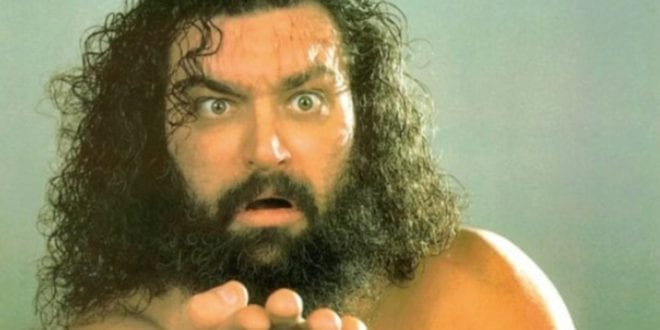 In this picture Bruiser Brody is looking into the camera, his hand extended.