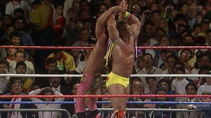 The Ultimate Warrior muscles out of a test of strength with Rick Rude during their Intercontinental title match at WrestleMania 5