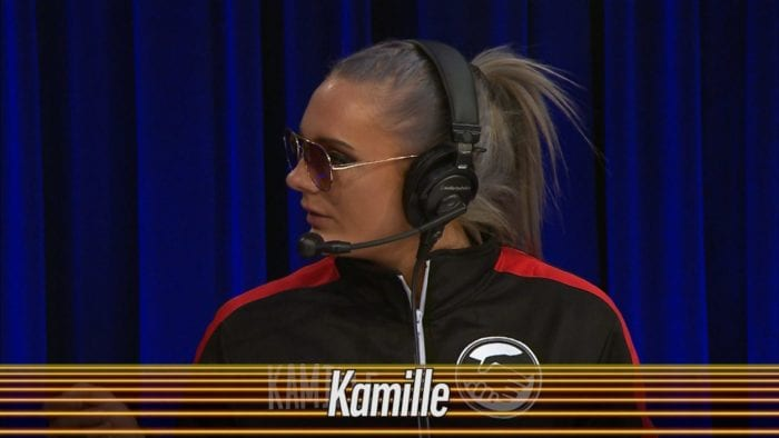 Kamille stares out an unseen Joe Galli at the announce desk