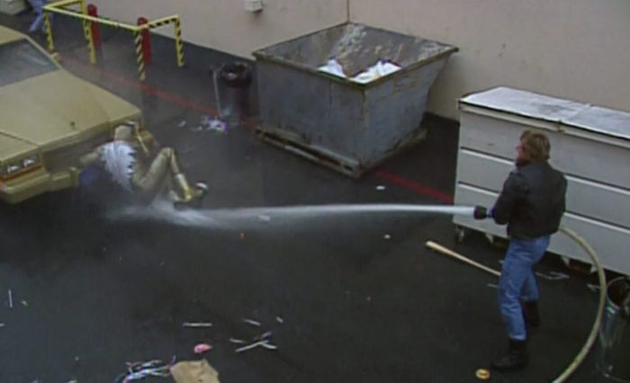 Piper sprays Goldust with the hose