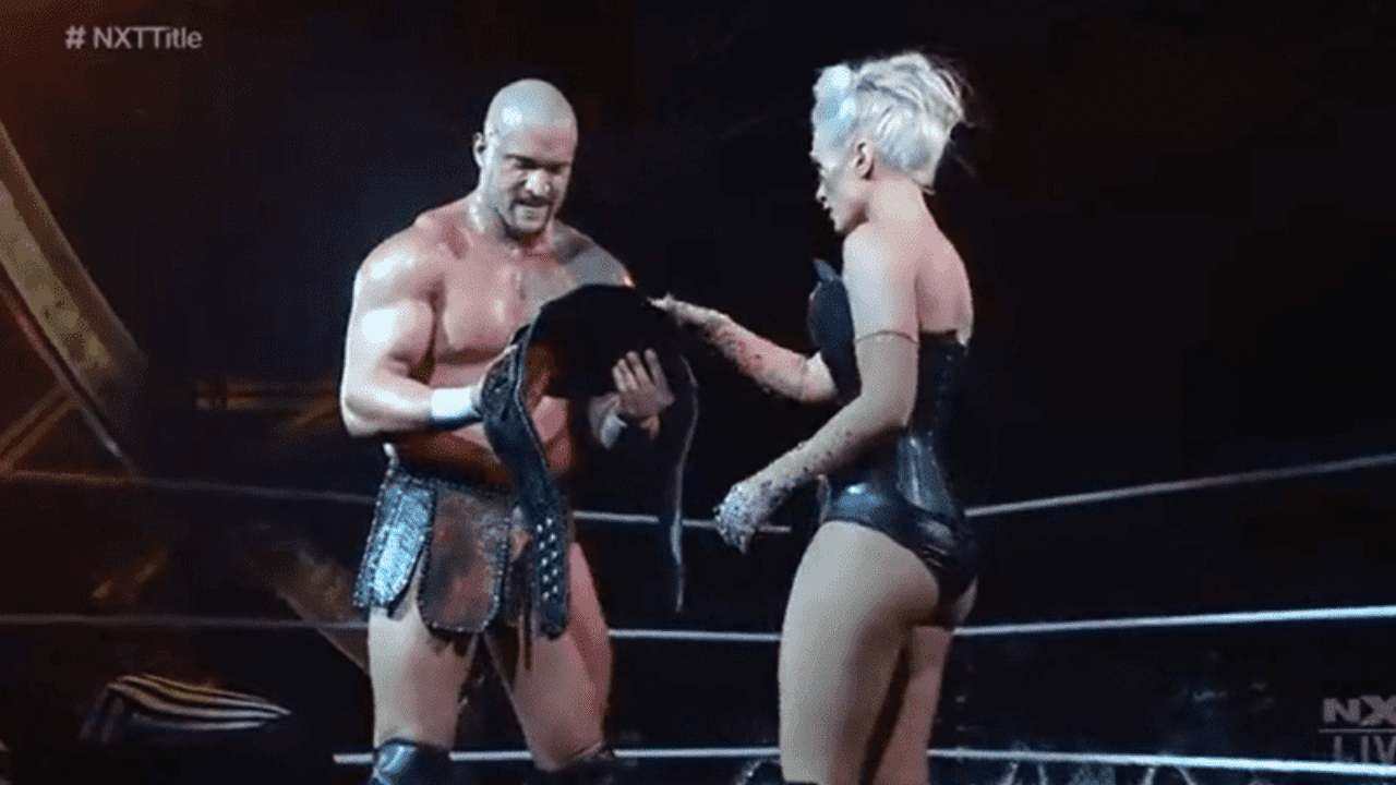 Scarlett presents Karrion Kross with the NXT Championship at Stand & Deliver
