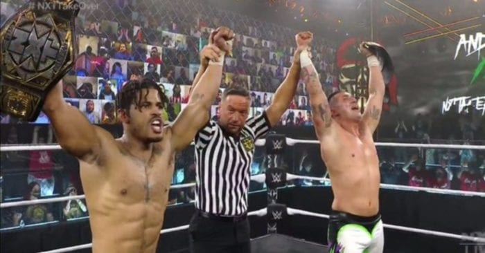 MSK have their arms raised with the NXT tag title belts at Stand & Deliver