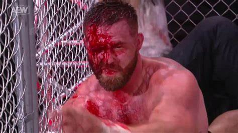 Dax Harwood wears the crimson mask during the Blood & Guts match