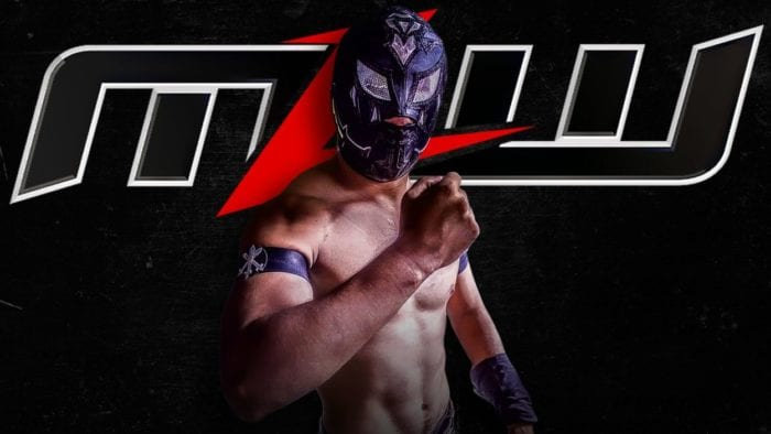Aramis poses in front of the MLW logo