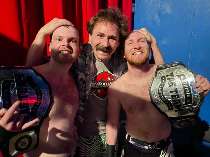 The Skimahorns and Uncle Mikey pose with the Memphis tag team titles