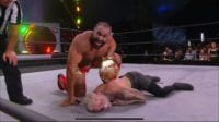 Miro clutches the TNT title belt and hovers over the lifeless body of Darby Allin