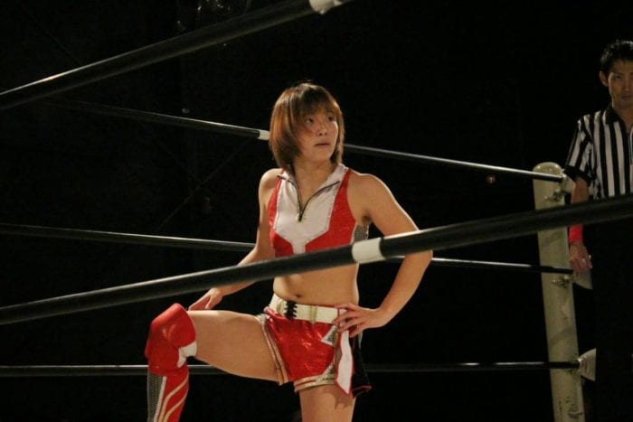 Hikaru Shida stares off moodily in the ring