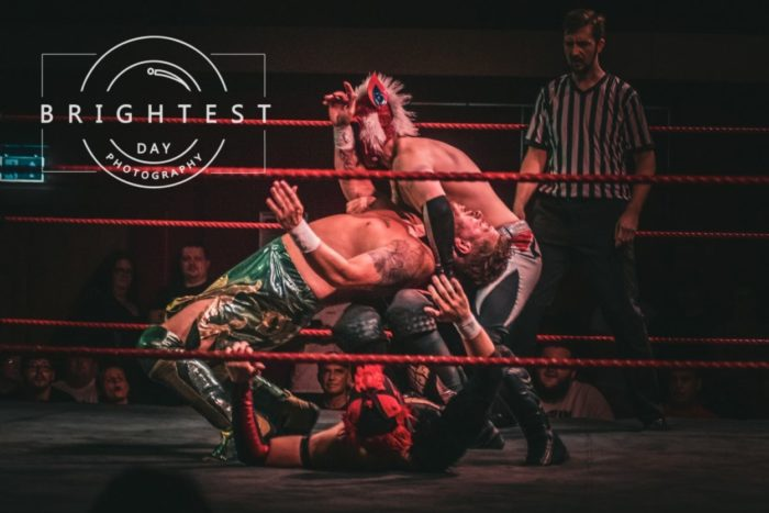 Lykos Gym get Dean Allmark into a combination submission move at Catch Pro-Wrestling