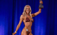 Taylor Hollohan holds her trophy high after winning all divisions in the CPA bikini competition.