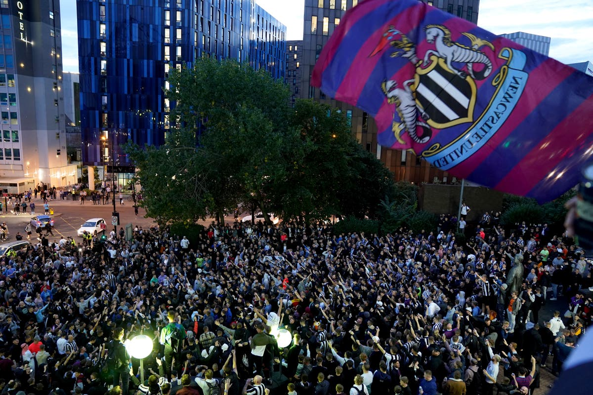The Newcastle United takeover and their fans celebrate wildly